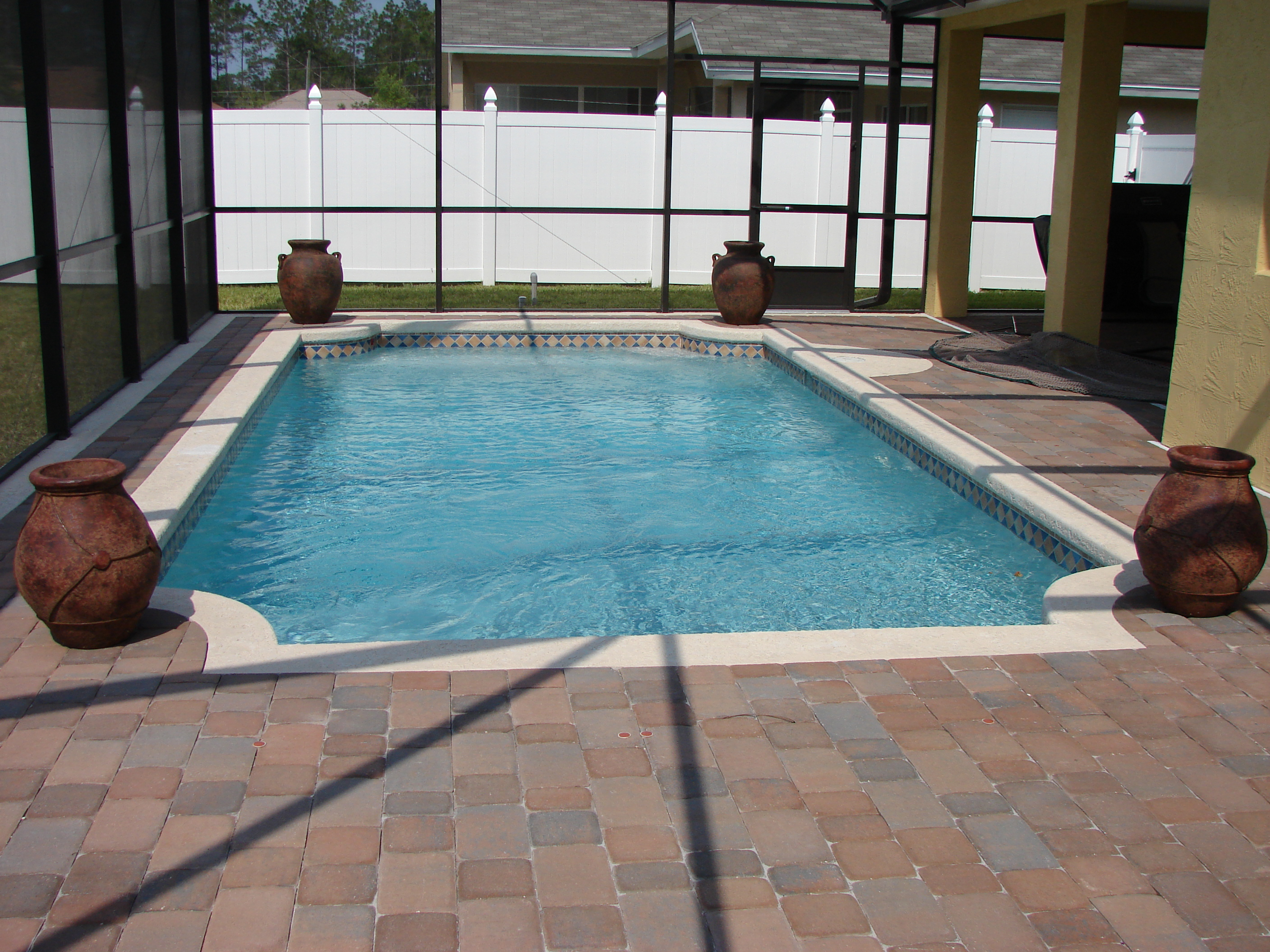 Swimming pools in palm coast ormond beach daytona for Images of inground swimming pools